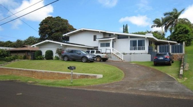 Photo from road of the exterior of a Kauai Home on behalf of Maile Properties of Kauai