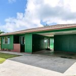 Front view of carport of 3 beds 2 baths Kapaa, Kauai home on behalf of Maile Properties of Kauai