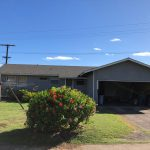 Front exterior, lawn, and drive of 3 beds 2 baths Kapaa, Kauai home on behalf of Maile Properties of Kauai